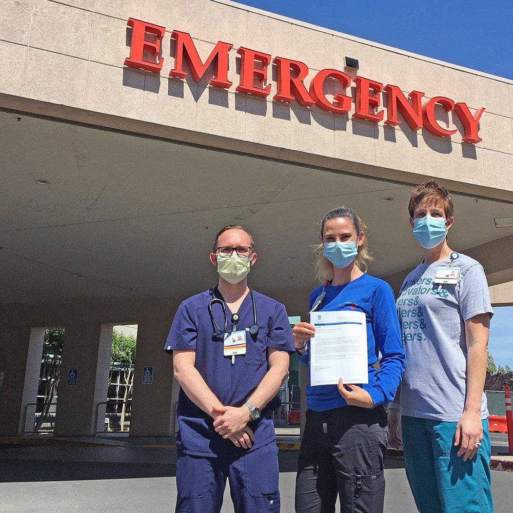 Nurses Justin Gaddis, Elizabeth Seely and emergency department manager Tambria Agnew work on the Sutter Davis Hospital Victim Intervention for Violence and Abuse program.